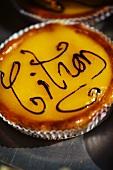 A lemon tart with writing