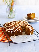Honey cake decorated with stripes of icing