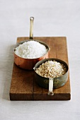 Two different types of rice in copper pots