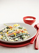 Vegetable salad with egg and yogurt