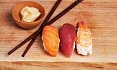 Sashimi Sushi (Salmon, Tuna, Shrimp) on Wood Board with Ginger and Chopsticks
