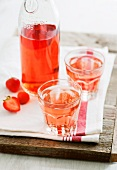 Strawberry cordial in a bottle and in glasses