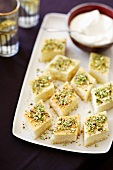 Semolina-yogurt cake with pistachios cut into slices