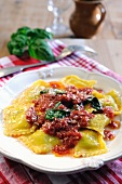 Spinach and ricotta filled ravioli pasta with tomato and fresh basil sauce