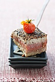 Flash fried tuna fillets with a pepper crust and cherry tomatoes