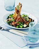 Rack of lamb with herb butter, saffron and vegetables
