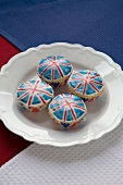 Four Union Jack Cupcakes on a White Plate
