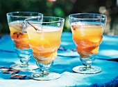 Fruit cocktails with cinnamon and star anise on a table in the garden