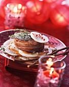 Venison tournedo serve on sliced turnip with a liquorice sauce