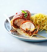 Monkfish wrapped in ham with spaghetti