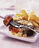 Beef steak with a pepper crust and chips