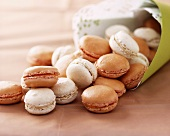 Macaroons falling out of a paper bag