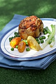 Stuffed veal escalope with potatoes and side of vegetables