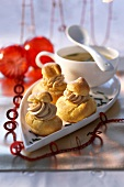 Profiteroles filled with goose liver cream for Christmas dinner