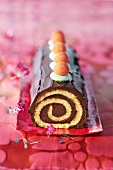 Chocolate Swiss roll decorated with sweets