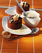 Chocolate cakes with vanilla sauce