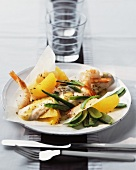 Sea bass with prawns, citrus fruits and mange tout