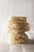 A stack of various rice noodles