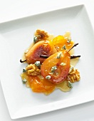 Poached Pears with Honey, Candied Walnuts and Blue Cheese