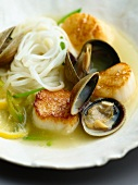 A Serving of Clams and Scallops with Noodles in a Lemon Wine Sauce