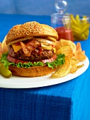 Bacon Cheeseburger with Mushrooms, Onions, Lettuce and Tomato; Potato Chips and a Pickle