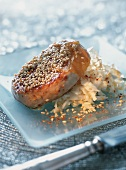 Fried goose liver with pepper and sesame seeds
