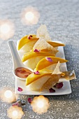 Sushi with mango and rose petals