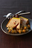 Toast with goose liver and grapes