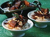 Caramelised pork with rice and pine nuts