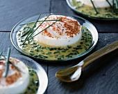 Poached eggs in chive sauce