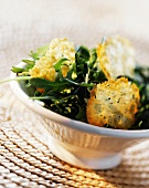 Rocket salad with Parmesan fritters