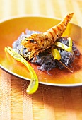 Marinated, flambéed prawns on a bed of glass noodles