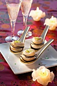Spoon canapés with scallops and black horseradish