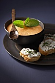 Melon soup and toasted bread topped with goat's cream cheese
