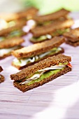 Rye bread sandwiches with avocado cream and crab meat