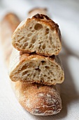 Baguette, whole and slice (close-up)
