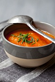 A bowl of carrot and pumpkin soup