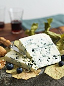 Wedge of Blue Cheese with Blueberries and Walnuts; Knife