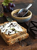 Goat Cheese Spread on Multi-Grain Bread with Cacao Nibs