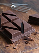 Dark Chocolate Bar on Rustic Table