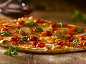 Gourmet Pizza Topped with Roasted Pear Tomatoes and Basil