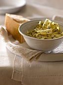 Pasta Tossed with Pesto; Wedge of Parmesan Cheese