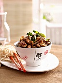Spicy stir-fried chicken with spring onions