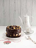 Coffee cake with chocolate glaze and hazelnuts