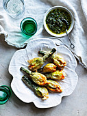 Deep-fried courgette flowers with ricotta, parmesan and mint and anchovy sauce