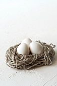 Three eggs in a nest of wool