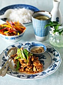 Stir-fried pork with rice, sesame seeds and vegetables (Thailand)