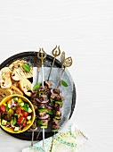 Lamb kebabs with vegetable salad and grilled bread (Turkey)