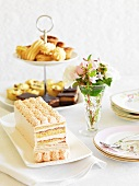 A Victoria Sponge Cake and a sweet pastries on a cake stand