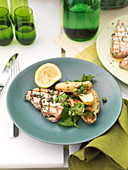 Grilled swordfish with peas, potatoes and herbs